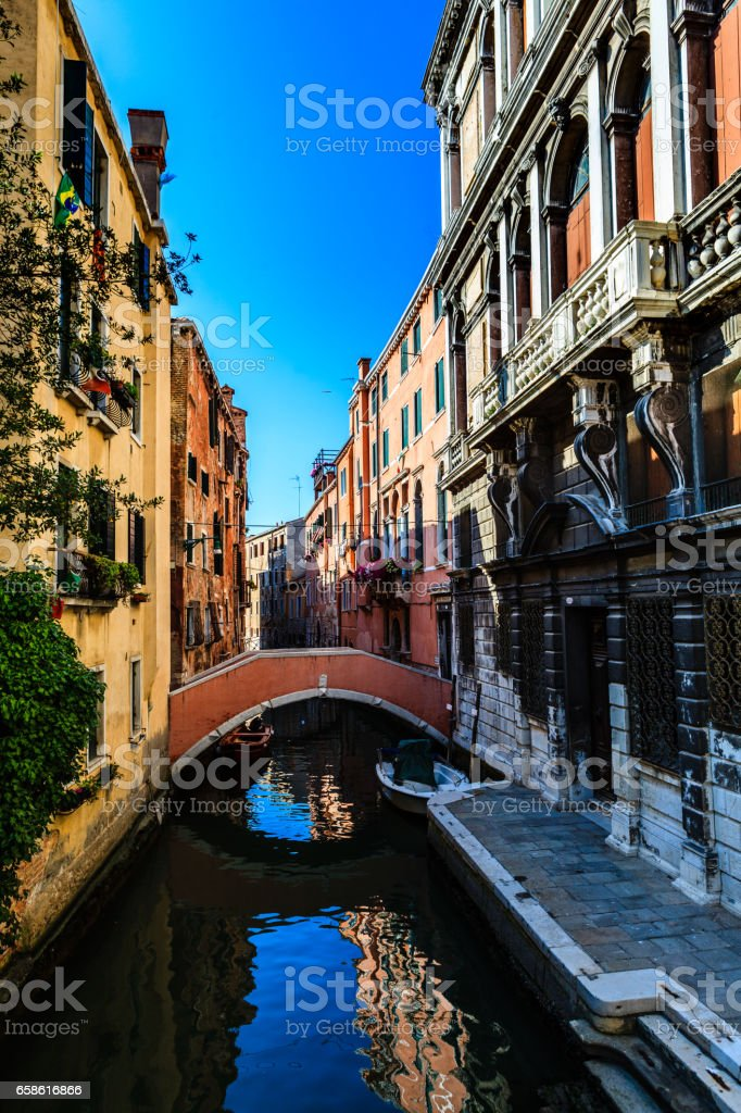 Beautiful summer day with typical canals and bridges of Venice stock photo