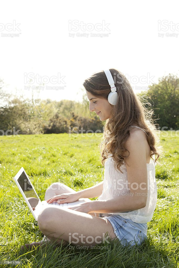 Beautiful summer girl with laptop royalty-free stock photo