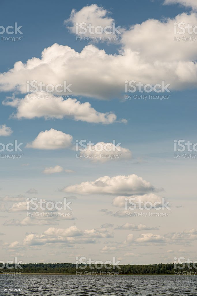 Beautiful summer lake, on  background of forest and cloudy sky stock photo