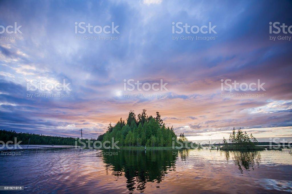Beautiful summer sunset landscape on the lake stock photo
