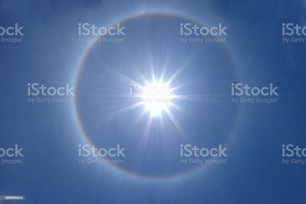 beautiful sun halo on clear blue sky stock photo