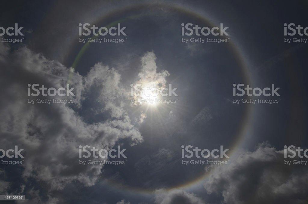Beautiful sun halo with the blue sky stock photo