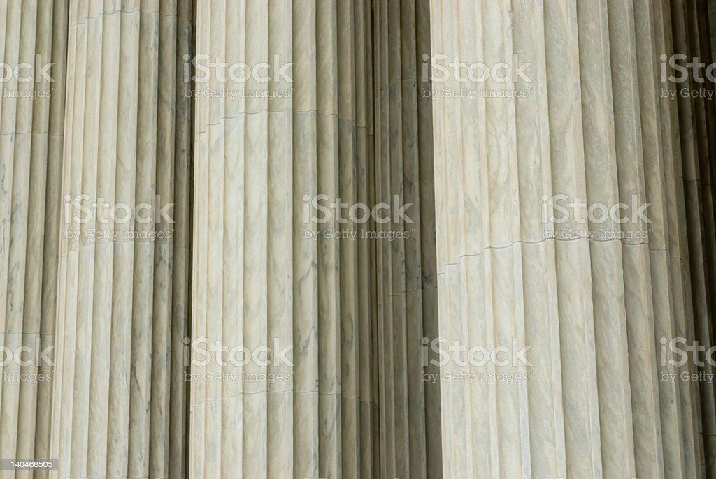 Beautiful sun lit building columns background texture royalty-free stock photo