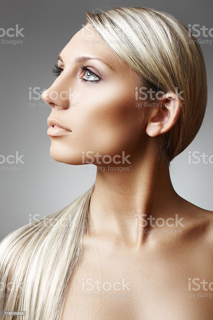 Beautiful sunburnt woman with chic long hair and clean skin royalty-free stock photo