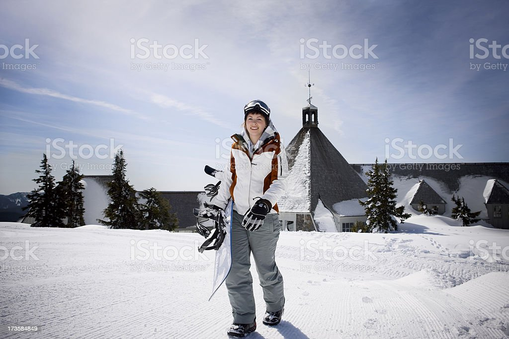 Beautiful Sunny Day and Happy Snowboarder Hiking Up Mountain, Copyspace royalty-free stock photo