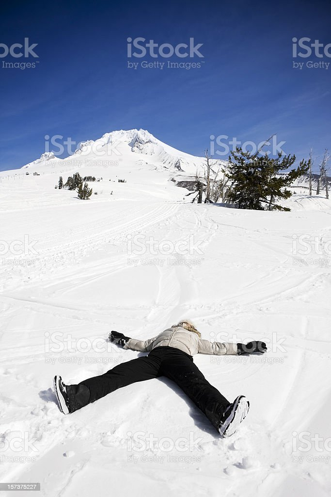 Beautiful Sunny Day on Snowy Mountain, Snow Angel, Copy Space royalty-free stock photo