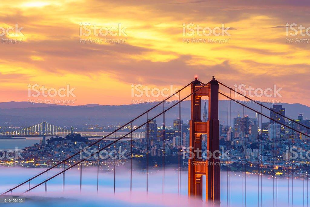 Beautiful sunrise at Golden Gate Bridge in Low Fog stock photo