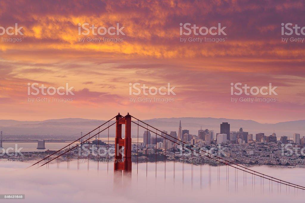 Beautiful sunrise at Golden Gate Bridge in Low Fog royalty-free stock photo