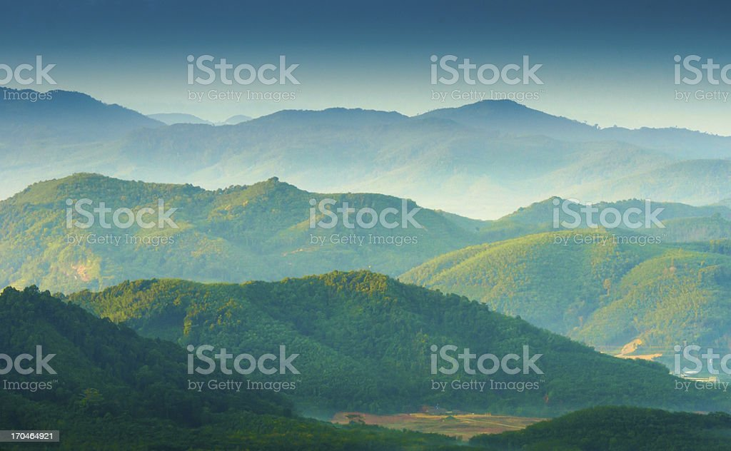 Beautiful sunrise at misty morning mountains . stock photo