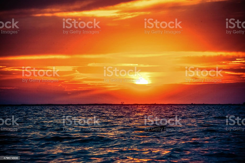 Beautiful sunrise in the sea stock photo