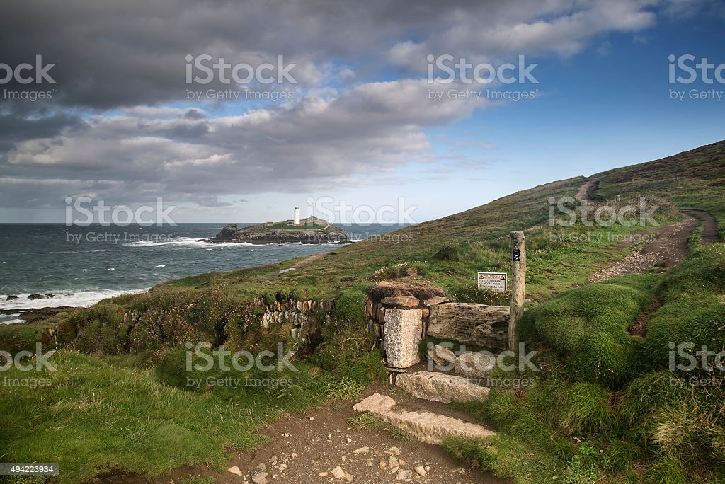 Beautiful sunrise landscape image of Godrevy in Cornwall stock photo