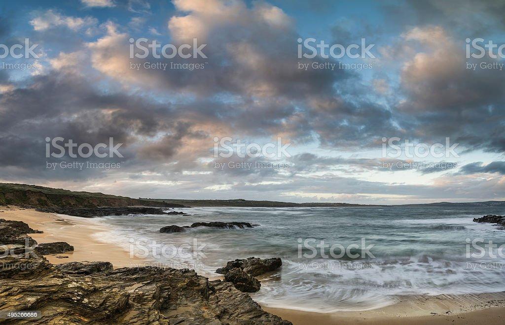 Beautiful sunrise landscape image of Godrevy in Corwnall England stock photo