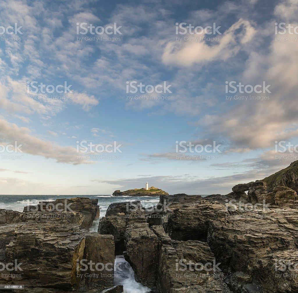 Beautiful sunrise landscape of Godrevy lighthouse on Cornwall co stock photo