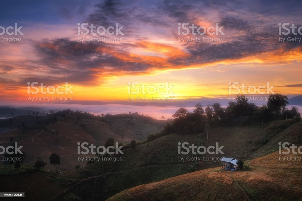 Beautiful sunrise landscape view on hill with colorful sky stock photo
