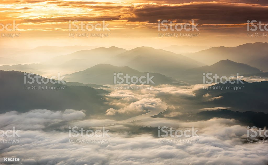 Beautiful Sunrise of travel place with morning mist stock photo