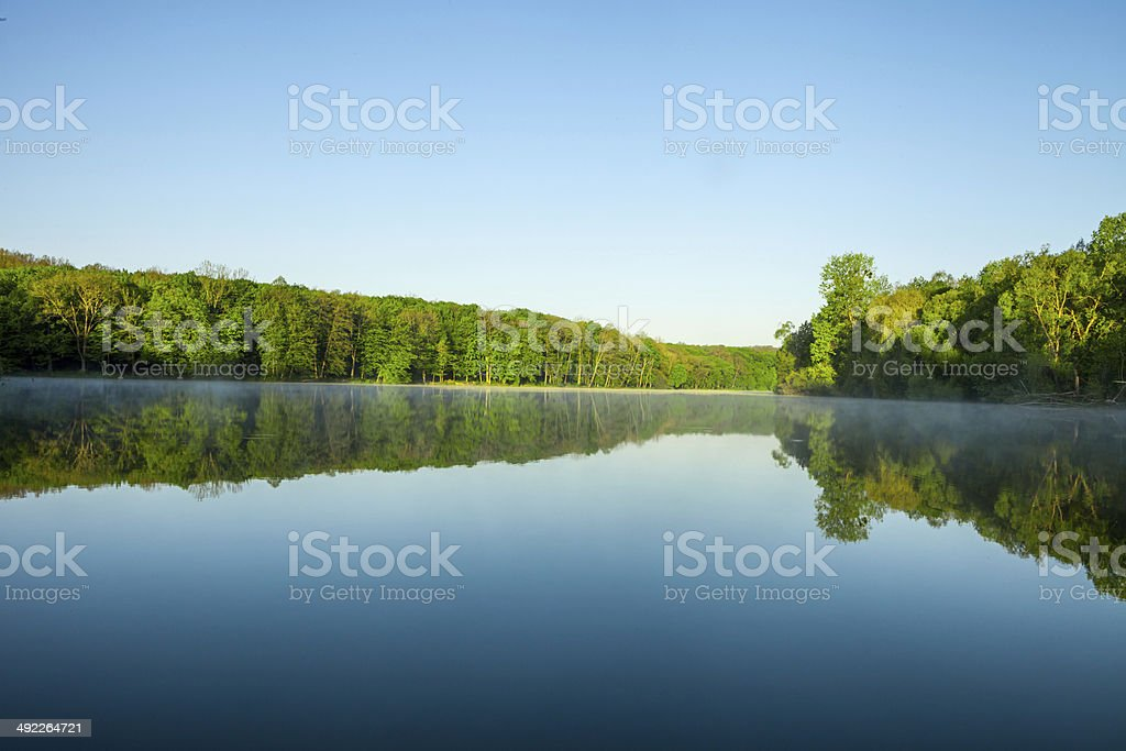 beautiful sunrise on the lake stock photo
