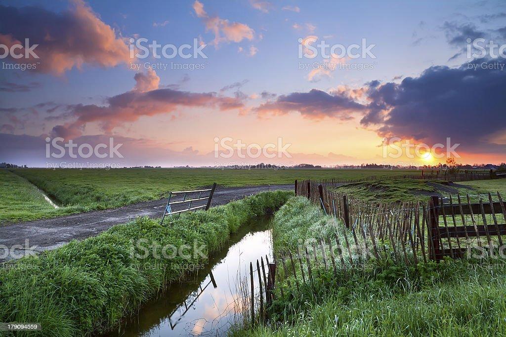 beautiful sunrise over farmland royalty-free stock photo