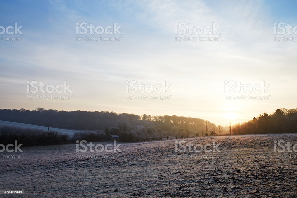 Beautiful Sunrise Over Frosty Country Landscape stock photo