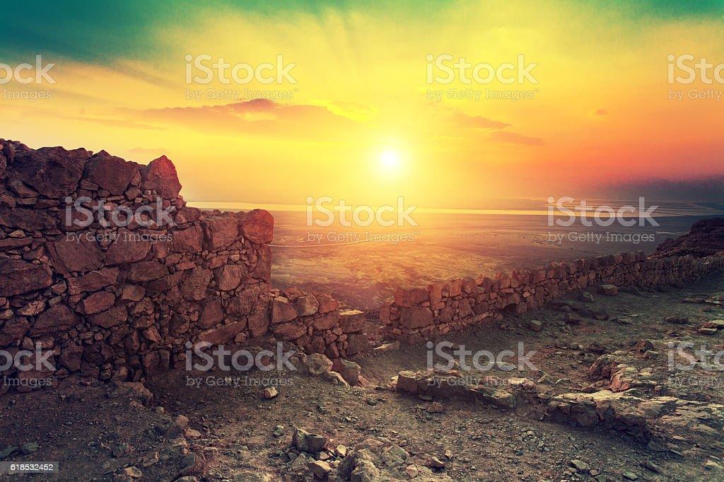 Beautiful sunrise over Masada fortress stock photo
