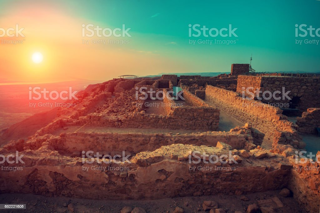 Beautiful sunrise over Masada fortress stock photo