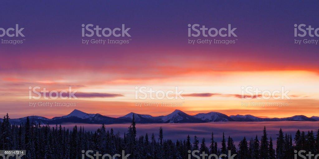 Beautiful Sunrise Over Mountain Range and Valley stock photo