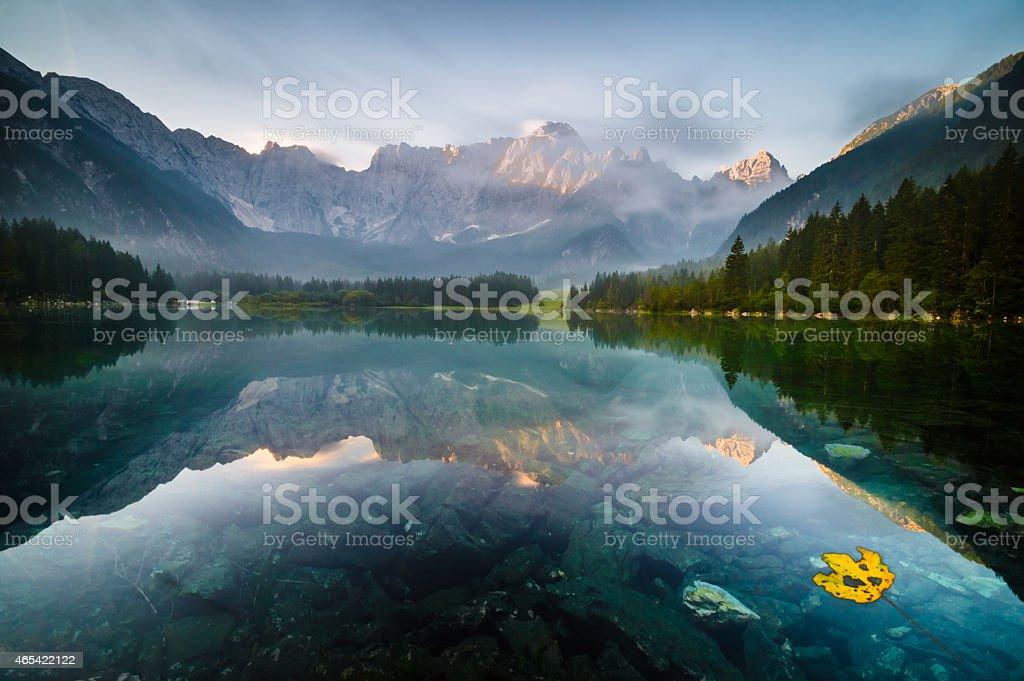 beautiful sunrise over the alpine lake stock photo
