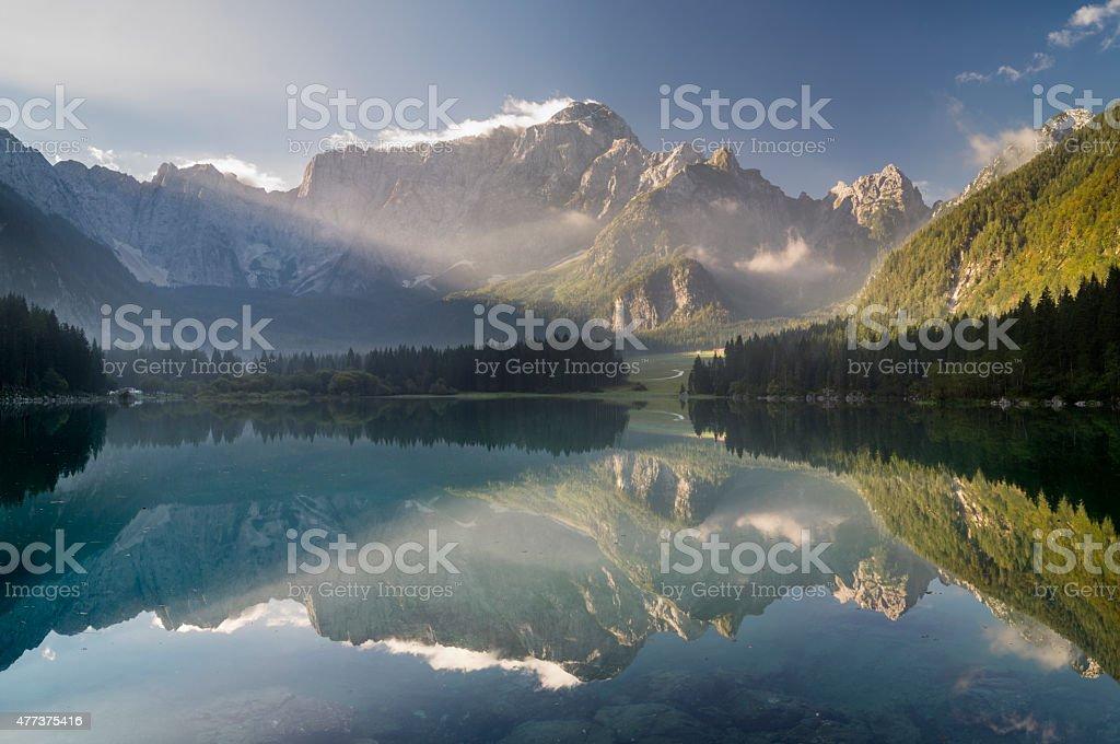 beautiful sunrise over the mountain lake in the Julian Alps stock photo