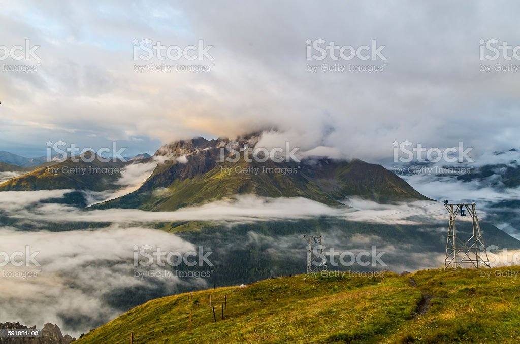 Beautiful sunrise with clouds and fog in the mountains, Austria stock photo