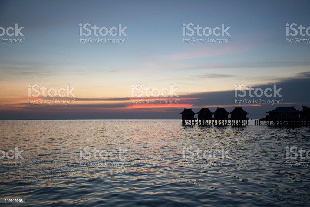 Beautiful sunset and bungalow. stock photo