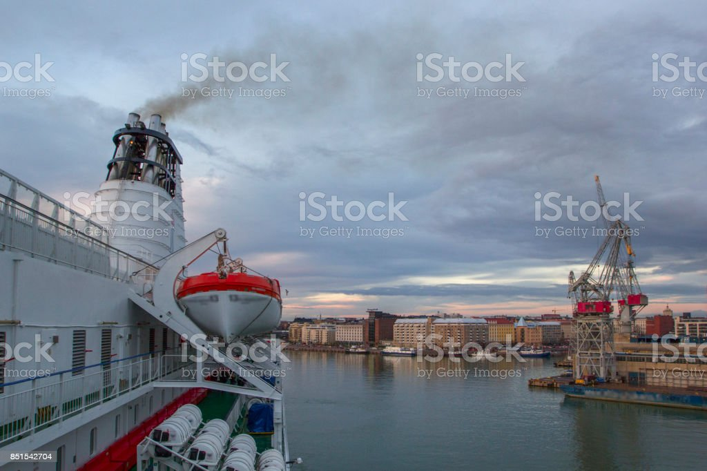 Beautiful sunset and modern seaport with cargo cranes and ships, Helsinki, Finland. stock photo