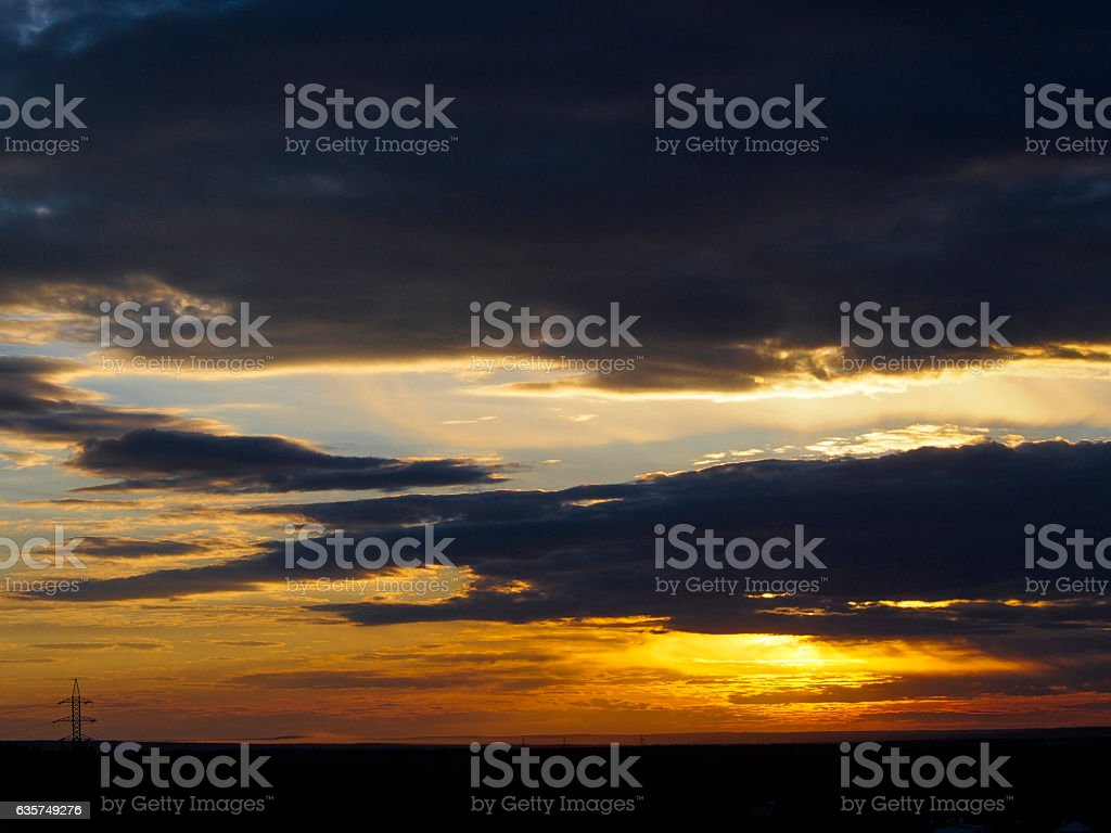 Beautiful sunset and power transmission line support silhouette stock photo