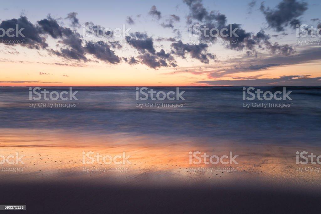 Beautiful sunset at the beach stock photo