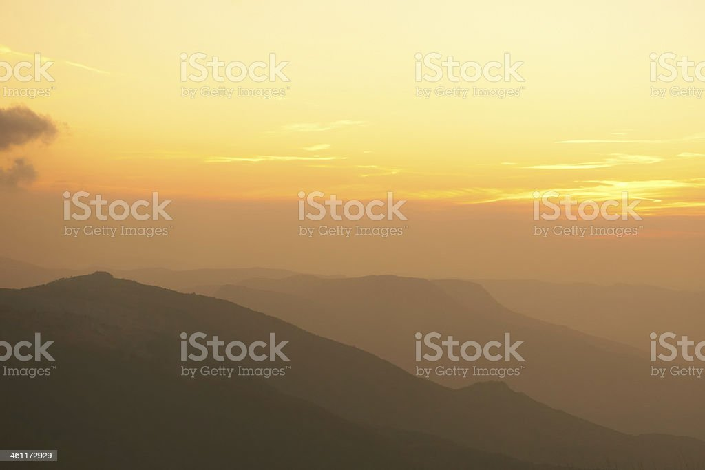 Beautiful sunset at the mountains. stock photo