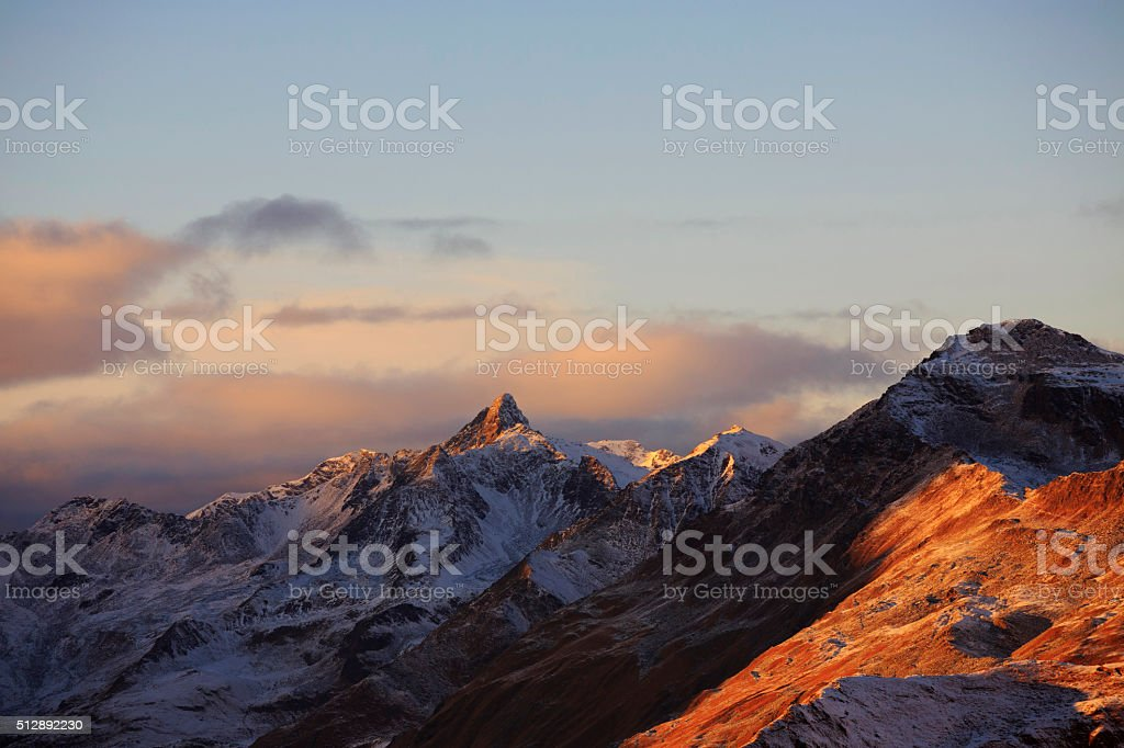 Beautiful sunset High mountain snowy  landscape  sunset  Europe Italian Alps stock photo