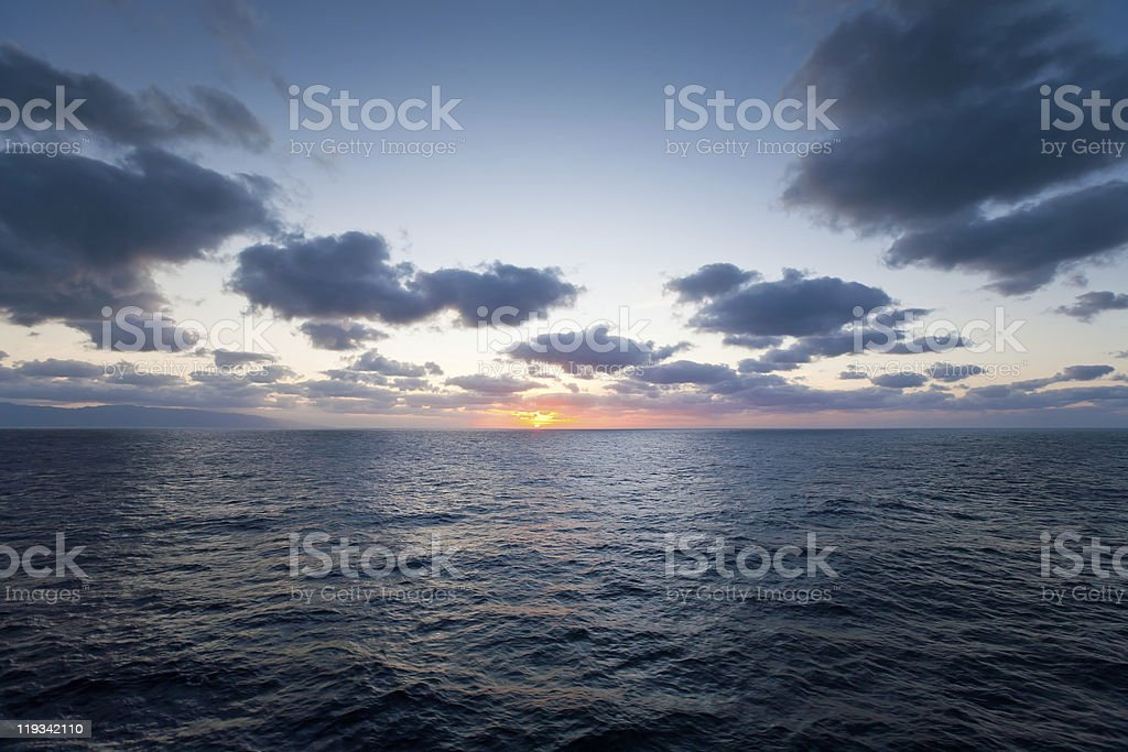Beautiful sunset in Atlantic ocean from deck of cruise ship royalty-free stock photo