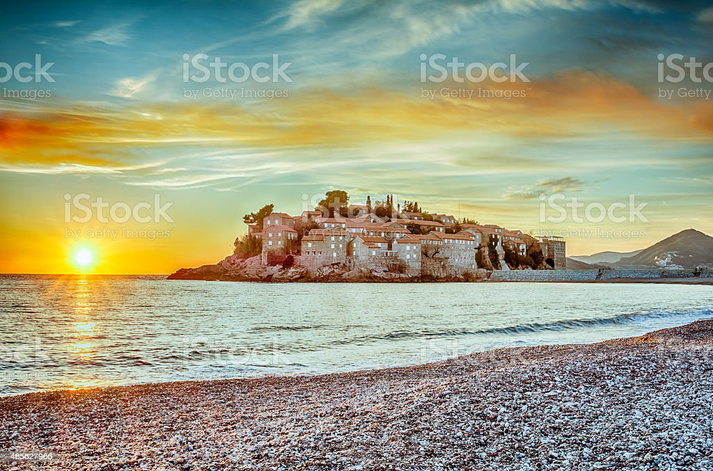 Beautiful sunset in Sveti Stefan Island in Montenegro stock photo
