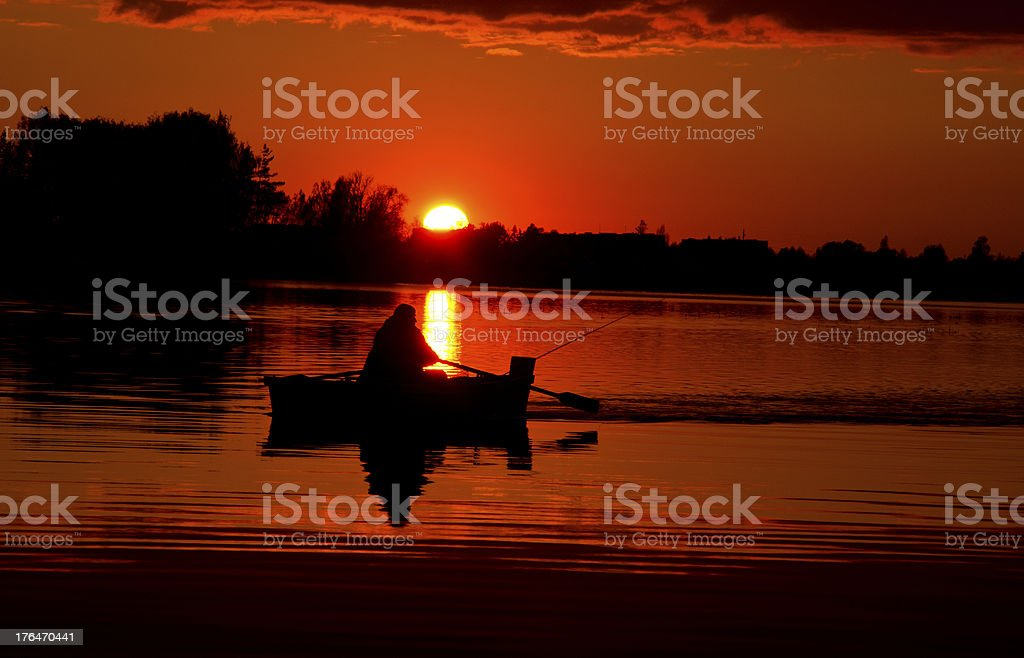 beautiful sunset in the lake and boat royalty-free stock photo
