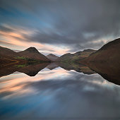 Beautiful sunset landscape image of Wast Water and mountains