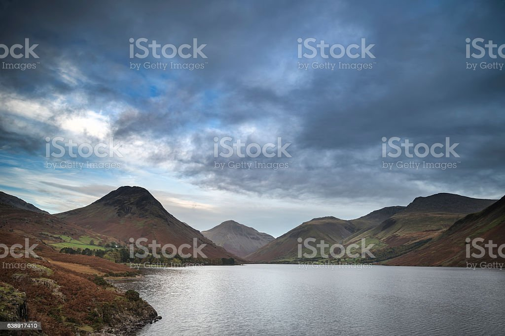 Beautiful sunset landscape image of Wast Water and mountains stock photo