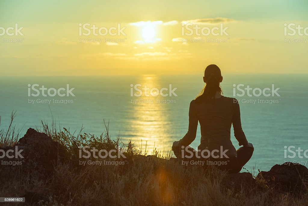 Beautiful sunset meditation stock photo