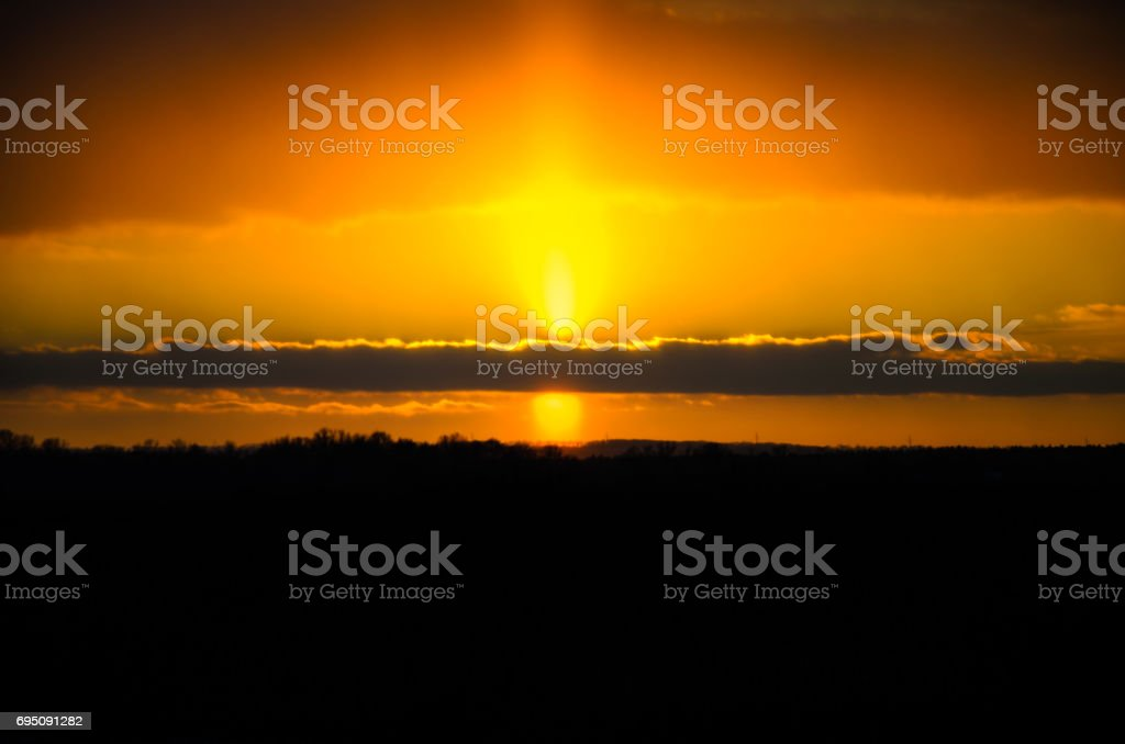 Beautiful sunset on a meadow on winter stock photo