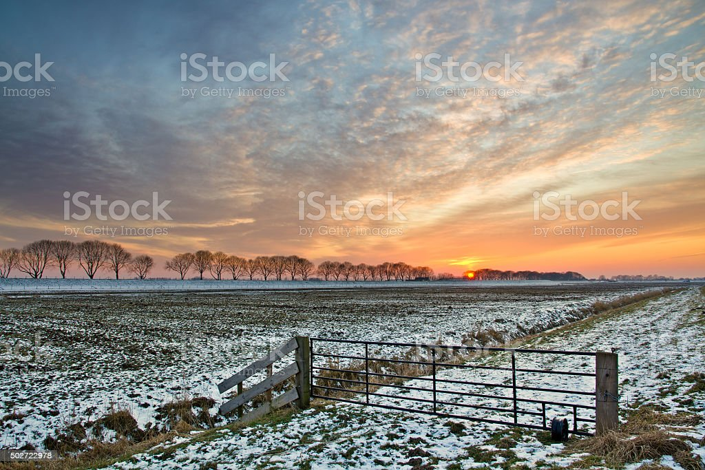 Beautiful sunset on a nice winterday with little snow. stock photo