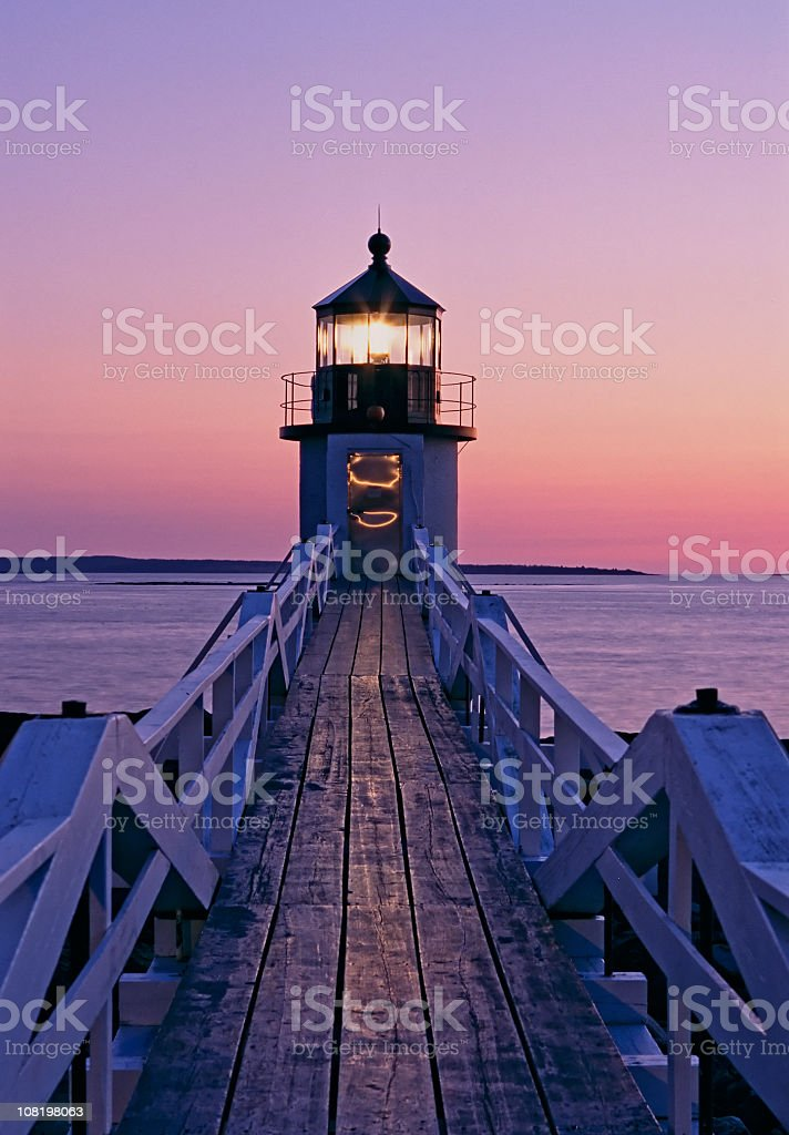 Beautiful sunset on the Marshal Point lighthouse stock photo