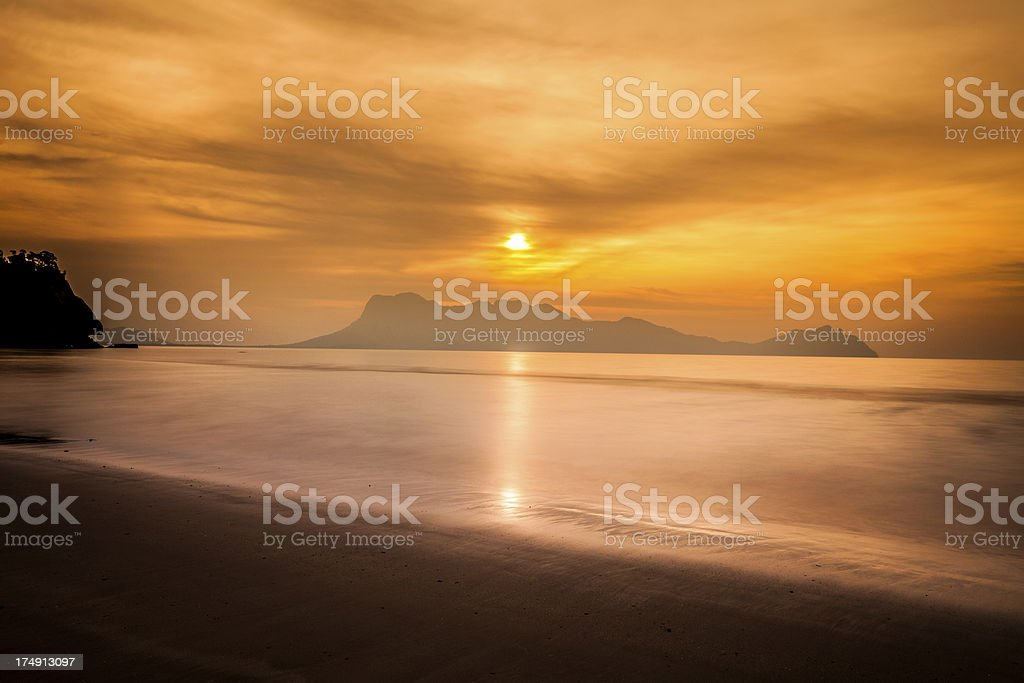 Beautiful Sunset on The Ocean at Bako national Park, Malaysia royalty-free stock photo