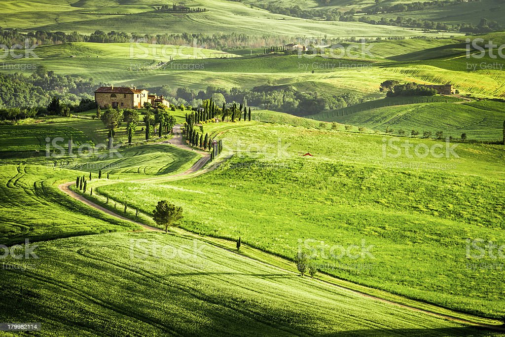 A beautiful sunset over a farmhouse in Tuscany stock photo