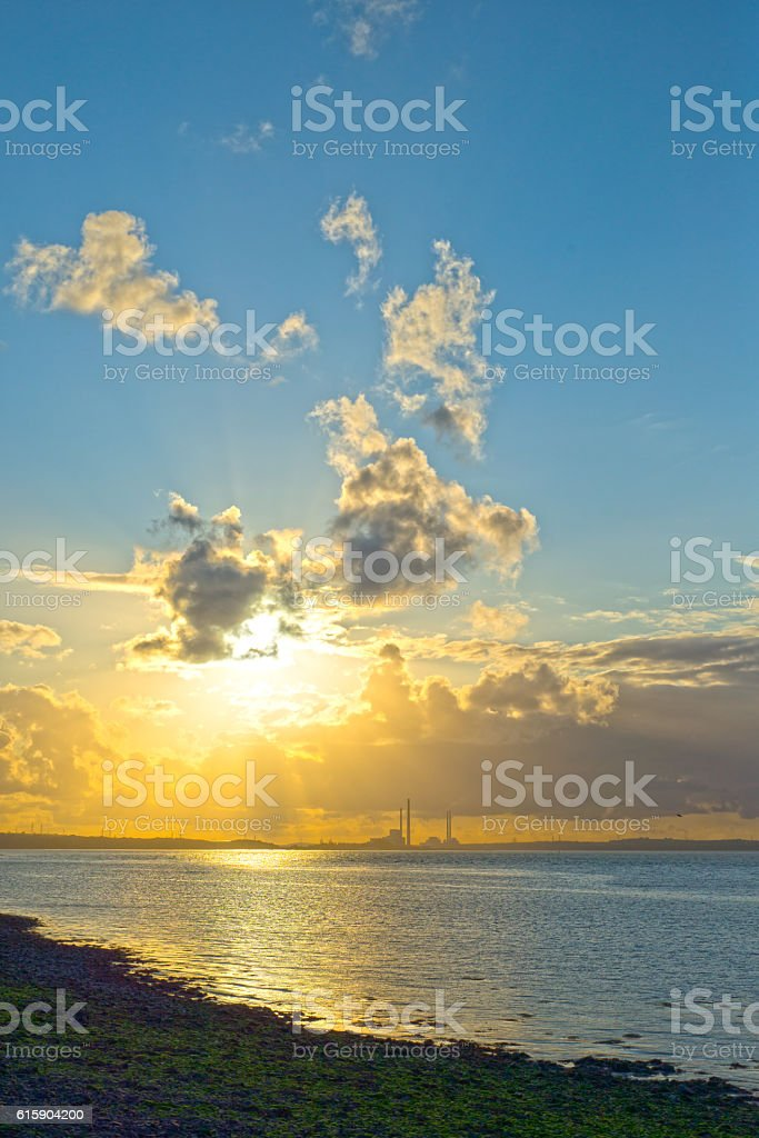 beautiful sunset over a power station stock photo