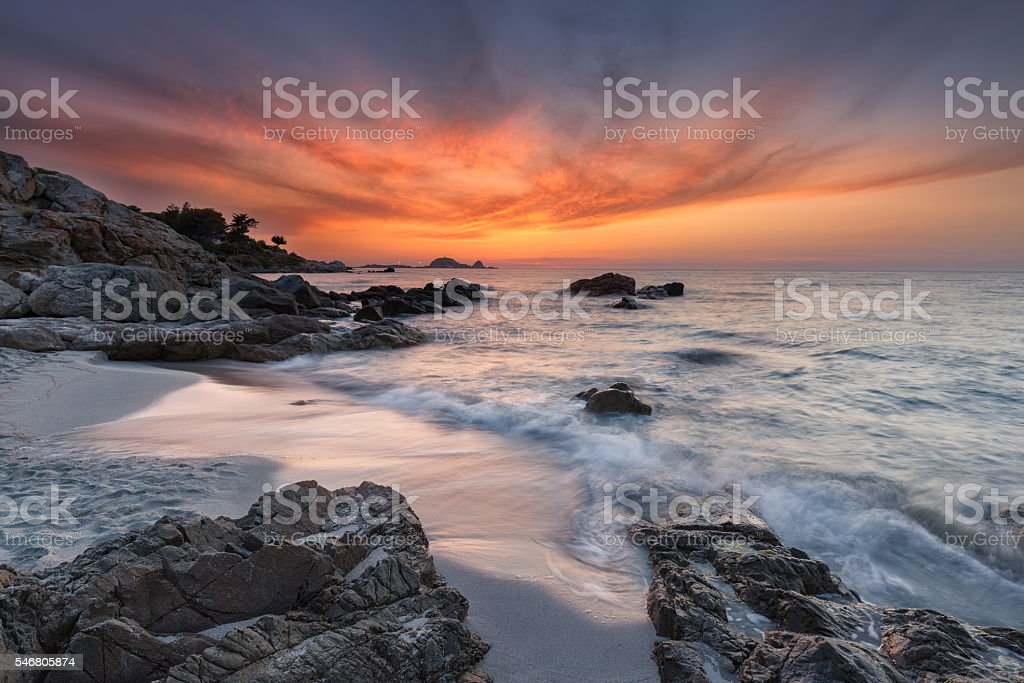 Beautiful sunset over coast and L'Ile Rousse in Corsica stock photo