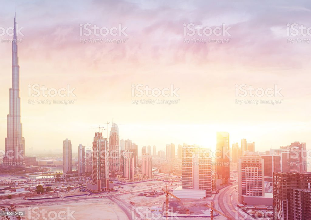 Beautiful sunset over Dubai city stock photo