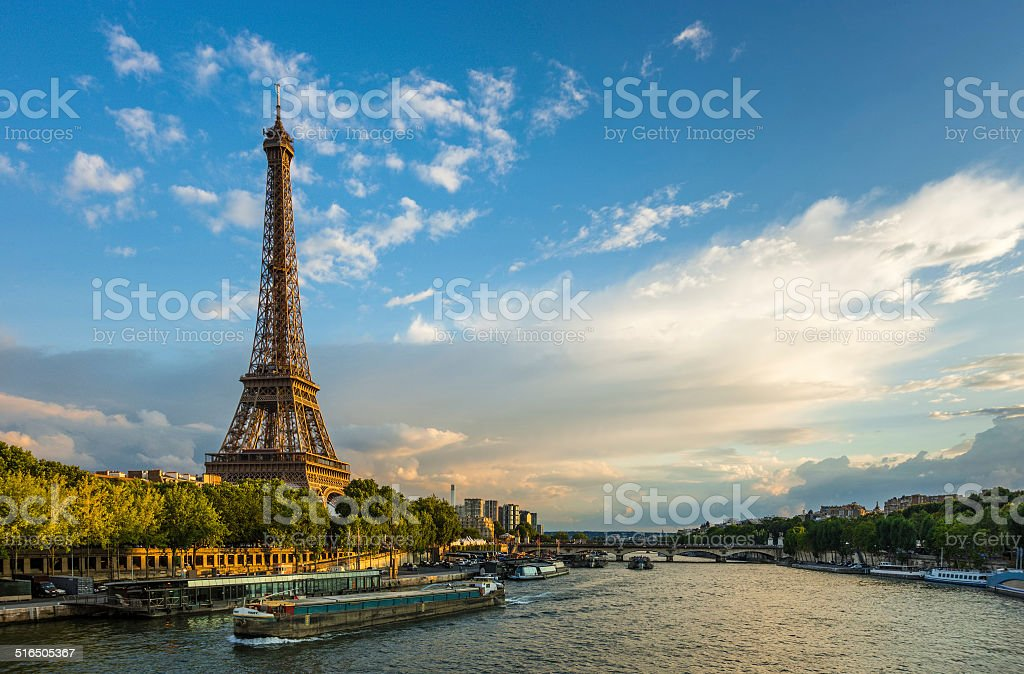 Beautiful sunset over Eiffel Tower and Seine river stock photo