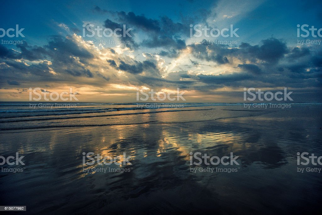 Beautiful Sunset over Empty Beach stock photo